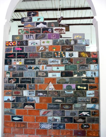 Unnikrishnan's Untitled paintings on terracotta bricks